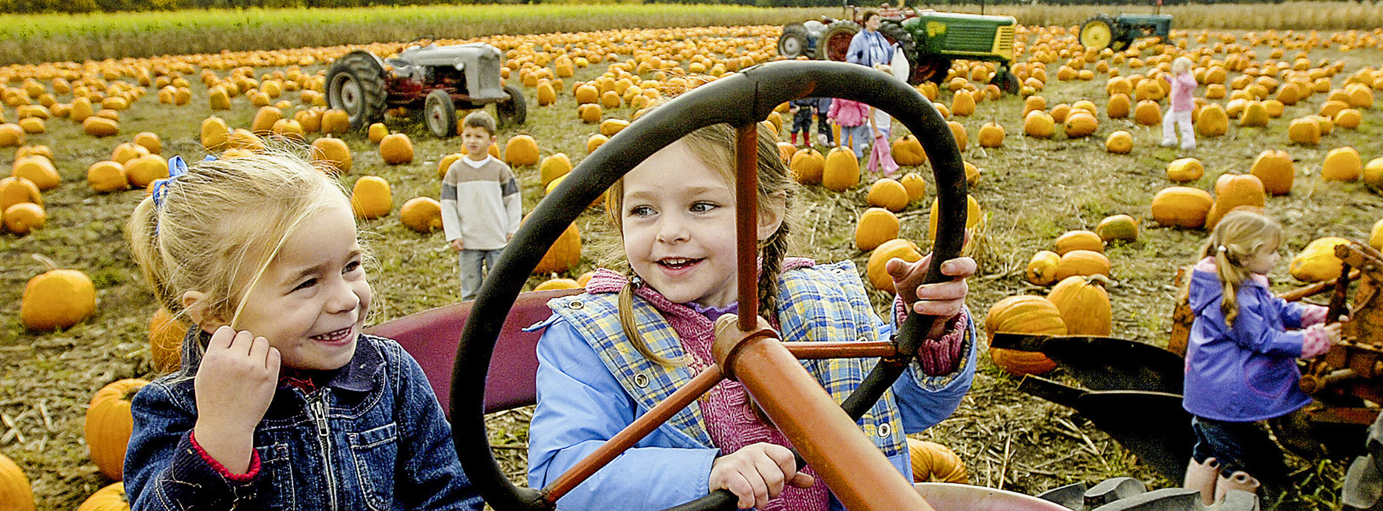 Young girls at pumpkin patch