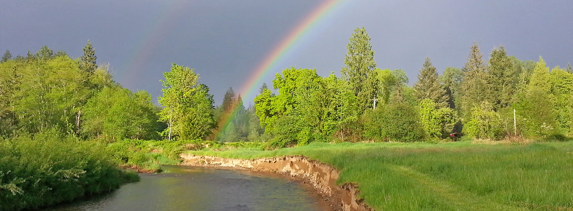photo of a rainbow over the Chehalis River