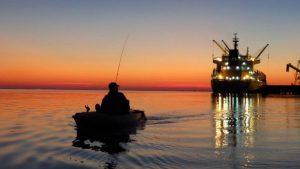 photo of fisherman at sunset